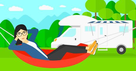 Woman lying in hammock.