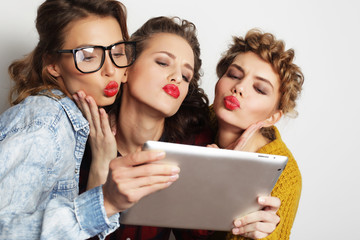 three teen girls friends taking selfie with digital tablet