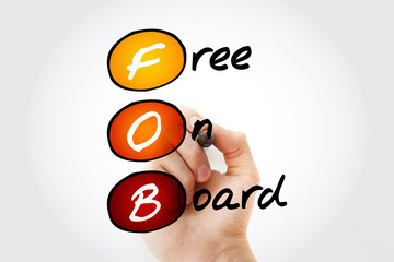 Hand writing FOB - Free On Board with marker, acronym business concept