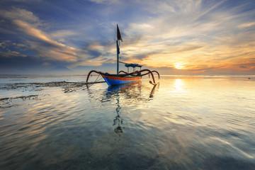 Traditional Balinese fishing boat Jukung at Sanur beach in Bali