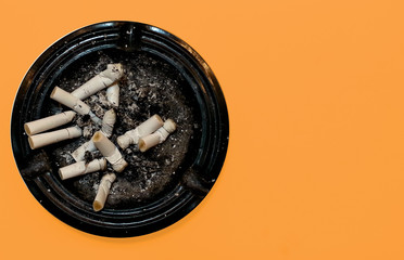 Dirty round dirty ashtray with cigarette butts and stubs extinguished
