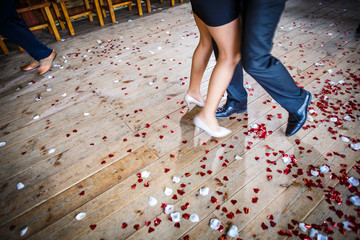 Couple dancing on a dance floor during a wedding celebration