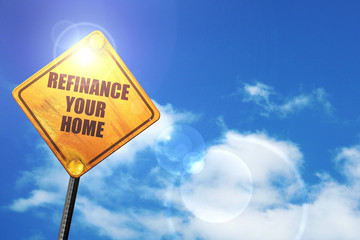 Yellow road sign with a blue sky and white clouds: refinance you