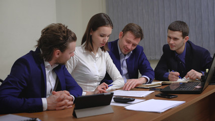 The team of young businesspeople. The meeting, brainstorming. In the office.