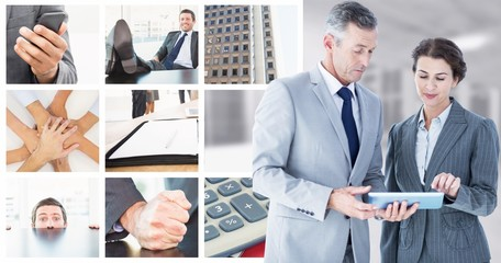 Composite image of business people looking at tablet