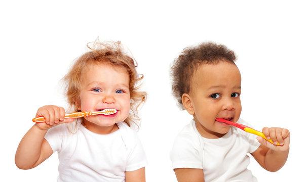 Black and white baby toddlers brushing teeth