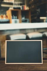Composite image of square bar stools at the counter