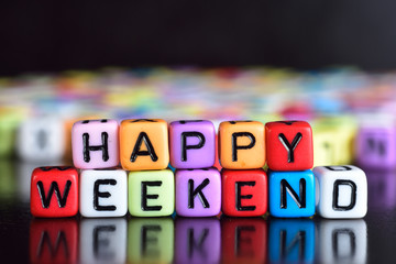Happy weekend on wooden table