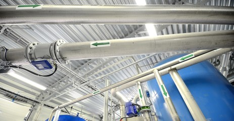 new shiny pipes and large tanks in industrial boiler room