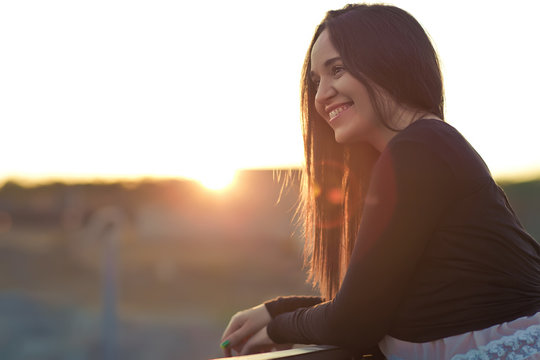 Beautiful woman and sun down