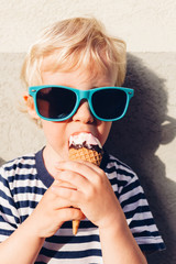 Cute kid boy eating ice cream