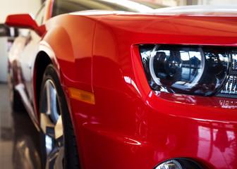 Varna, Bulgaria - Circa December 2015: New red Chevrolet Camaro SS. Front close-up. Showroom 'Perfect Auto'.
