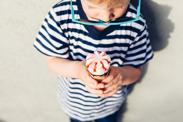 Cute kid boy eating ice cream