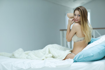 beautiful woman in a morning bed