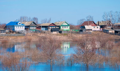Spring flood of the river and the village on the shore