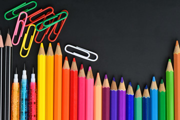 Pencil crayons on black background, Flat lay