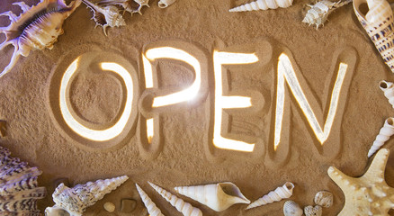 Open symbol in the sand. Beach background. Top view