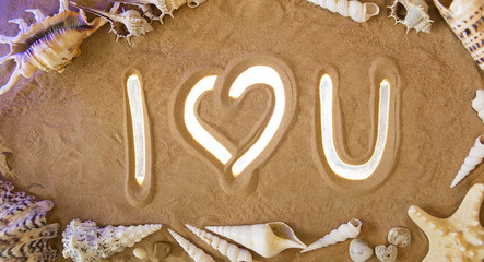 I Love You symbol in the sand. Beach background. Top view