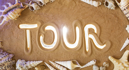 Tour symbol in the sand. Beach background. Top view