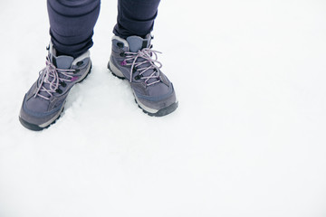 Mountain boots on the snow