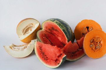 Melon, watermelon and pumpkin sliced on a white background, vegetarian food, fruits, vegetables, organic, healthy lifestyle