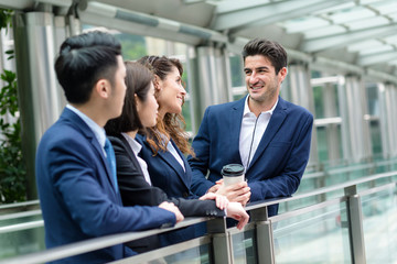 Group of business people discuss outside office
