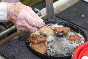 Grandmothers hand cooking and preparing food