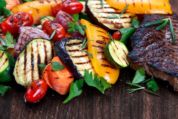 Grilled vegetables. On cutting dark board background