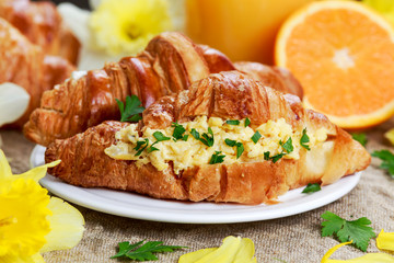 Summer Morning Breakfast Croissant stuffed scrambled eggs decorated with flowers.