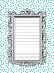 Close-up of one silver Baroque picture frame with striped paper sheet frame on aqua dotted background
