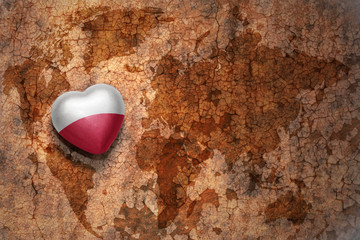 heart with national flag of poland on a vintage world map crack paper background