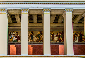 beautiful painting on the wall of the National & Kapodistrian University of Athens hidden behind columns