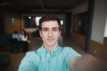 young man takes selfie