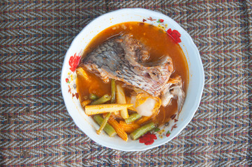 "sour soup made of tamarind paste with tilapia or ""Kaeng Som"""