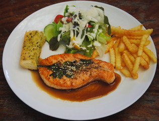 Salmon steak seafood with vegetable and french fries