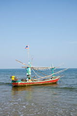 old wooden local fishing boat on on sea coast and beach with sum