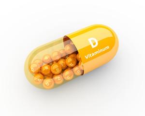 Fototapeta vitamin D capsule lying on desk obraz