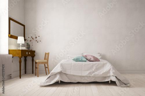 Schlafzimmer mit Doppelbett und Schreibtisch\