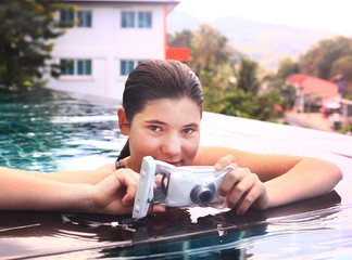 girl  in swimming pool with underwater camera