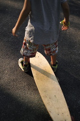 Young boy with long board