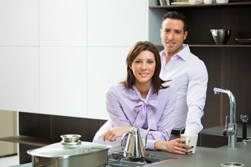 young happy couple in love in home kitchen