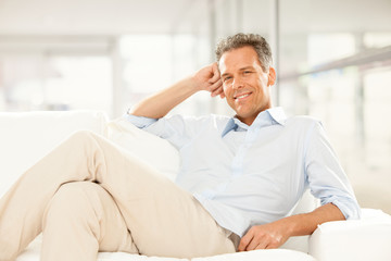 handsome businessman Relax on the couch at home