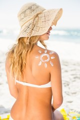 Woman with sunscreen on her skin