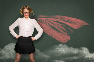 Super woman nerd geek teacher student in blackboard drawing cape successful confident powerful