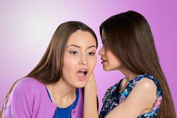 Two women gossip