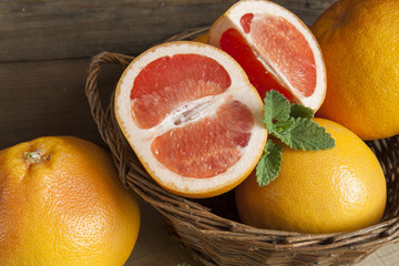 Freshly harvested grapefruit in basket