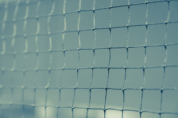 Close up of net in badminton court for sport background fade vintage filter
