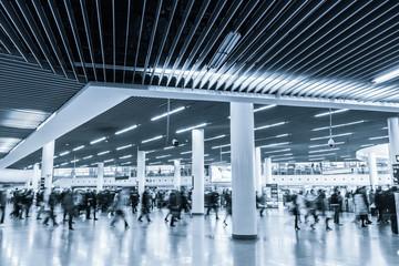 commuters motion blur in metro interchange center