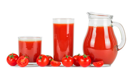 Tomato juice in glasses and fresh tomatoes .