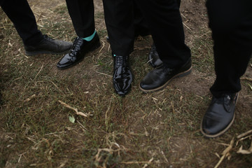 Black shoes on the ground in the wedding day